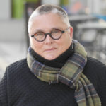 Bespectacled woman wearing a scarf