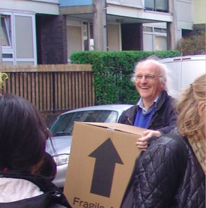 Nick Tyler carrying a cardboard box